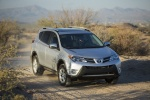 Picture of a driving 2014 Toyota RAV4 XLE in Classic Silver Metallic from a front right three-quarter perspective