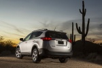 Picture of a 2014 Toyota RAV4 XLE in Classic Silver Metallic from a rear left three-quarter perspective