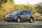 Picture of a driving 2014 Toyota RAV4 Limited in Magnetic Gray Pearl from a front left three-quarter perspective