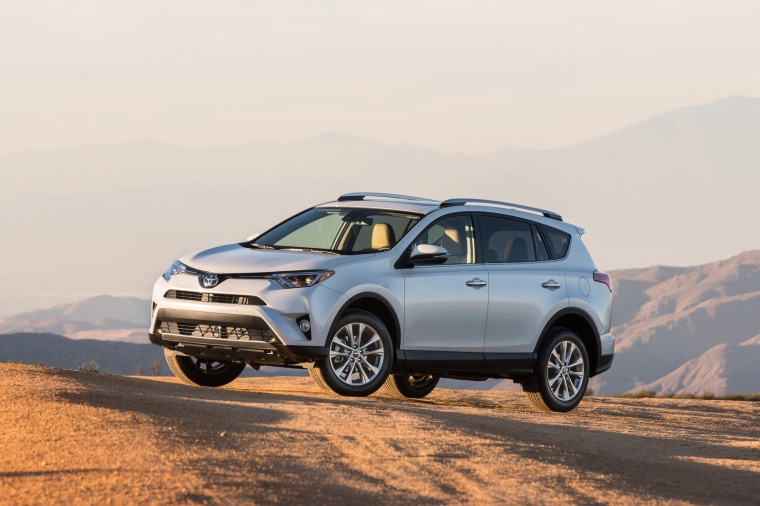Driving 2016 Toyota RAV4 Limited AWD in Super White from a front left three-quarter view