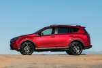 Picture of a driving 2016 Toyota RAV4 SE AWD in Barcelona Red from a left side perspective