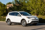 Picture of a driving 2016 Toyota RAV4 Hybrid XLE AWD in Super White from a front right three-quarter perspective