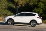 Picture of a driving 2016 Toyota RAV4 Hybrid XLE AWD in Super White from a left side perspective