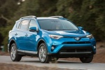 Picture of a driving 2016 Toyota RAV4 Hybrid Limited AWD in Electric Storm Blue from a front right three-quarter perspective