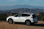 2016 Toyota RAV4 Limited AWD in Super White - Driving Rear Left Three-quarter View