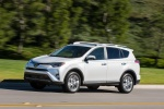 Picture of a driving 2016 Toyota RAV4 Limited AWD in Super White from a front left three-quarter perspective
