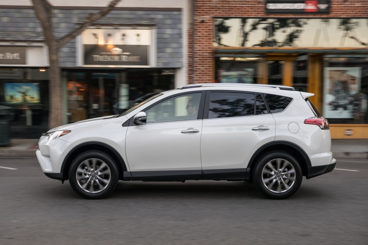 Picture of a driving 2017 Toyota RAV4 Limited AWD in Super White from a left side perspective