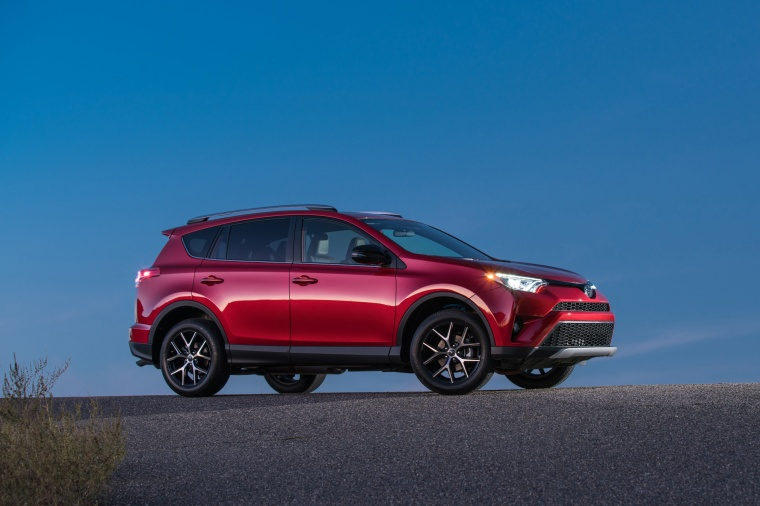 Picture of a driving 2017 Toyota RAV4 SE AWD in Barcelona Red from a front right three-quarter perspective