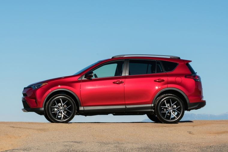 Picture of a driving 2017 Toyota RAV4 SE AWD in Barcelona Red from a left side perspective