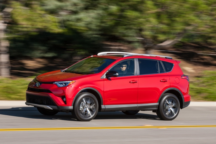 Driving 2017 Toyota RAV4 SE AWD in Barcelona Red from a front left three-quarter view