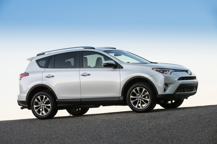 Driving 2017 Toyota RAV4 Limited AWD in Super White from a right side view
