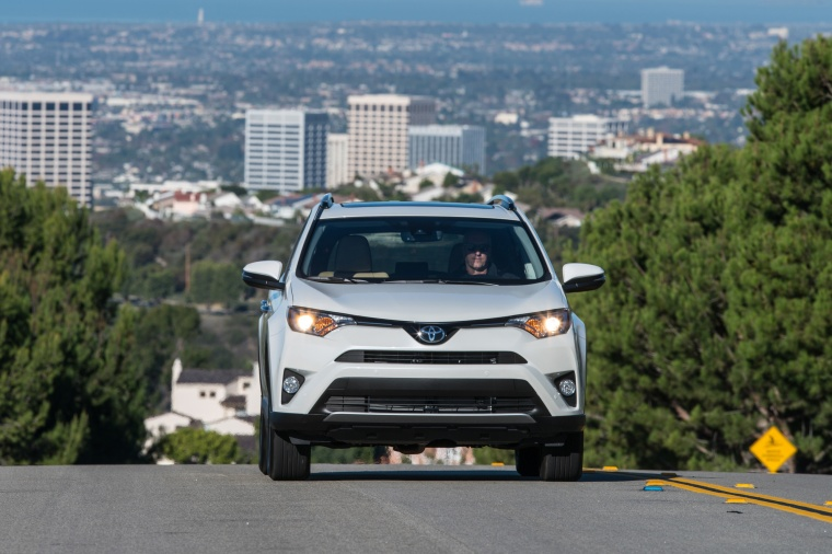 Picture of a driving 2017 Toyota RAV4 Limited AWD in Super White from a frontal perspective