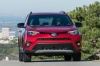 Picture of a driving 2017 Toyota RAV4 SE AWD in Barcelona Red from a frontal perspective