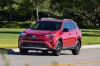 Driving 2017 Toyota RAV4 SE AWD in Barcelona Red from a front left view