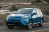 Driving 2017 Toyota RAV4 Hybrid Limited AWD in Electric Storm Blue from a front left view