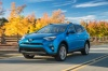 Driving 2017 Toyota RAV4 Hybrid Limited AWD in Electric Storm Blue from a front left three-quarter view