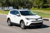 Driving 2017 Toyota RAV4 Limited AWD in Super White from a front right three-quarter view