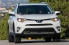 Driving 2017 Toyota RAV4 Limited AWD in Super White from a front right view