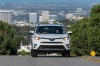 Driving 2017 Toyota RAV4 Limited AWD in Super White from a frontal view
