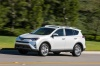 Driving 2017 Toyota RAV4 Limited AWD in Super White from a front left three-quarter view