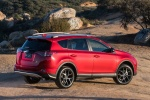 Picture of a driving 2017 Toyota RAV4 SE AWD in Barcelona Red from a rear right three-quarter perspective