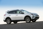 2017 Toyota RAV4 Limited AWD in Super White - Driving Right Side View