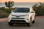 Picture of a driving 2017 Toyota RAV4 Hybrid XLE AWD in Super White from a front left perspective