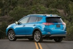 Picture of a driving 2017 Toyota RAV4 Hybrid Limited AWD in Electric Storm Blue from a rear left three-quarter perspective
