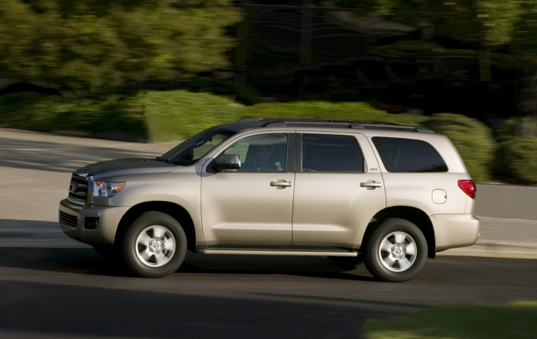 2012 toyota sequoia in sandy beach metallic color driving left side view picture image. Black Bedroom Furniture Sets. Home Design Ideas