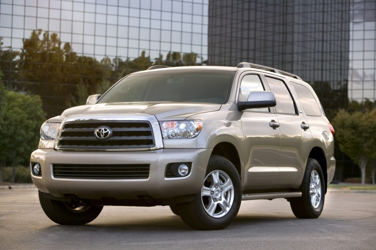 Picture of a 2016 Toyota Sequoia in Sandy Beach Metallic from a front left three-quarter perspective