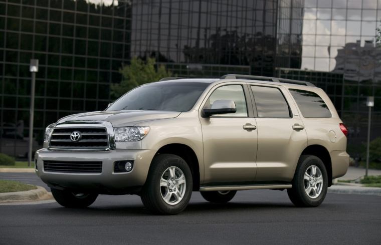 Picture of a 2016 Toyota Sequoia in Sandy Beach Metallic from a front left perspective