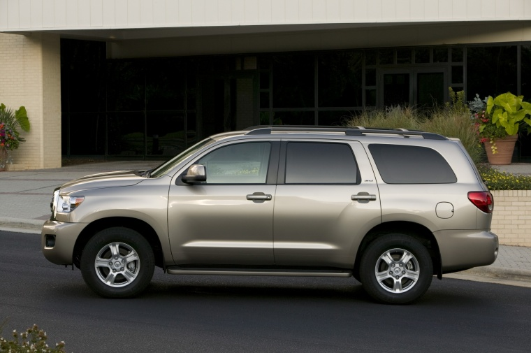 Picture of a 2016 Toyota Sequoia in Sandy Beach Metallic from a left side perspective