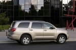 Picture of a 2016 Toyota Sequoia in Sandy Beach Metallic from a rear side perspective