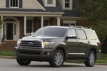 Picture of a 2016 Toyota Sequoia in Pyrite Mica from a front left three-quarter perspective