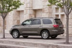 Picture of a 2016 Toyota Sequoia in Pyrite Mica from a rear left three-quarter perspective