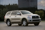Picture of a 2016 Toyota Sequoia in Sandy Beach Metallic from a front right three-quarter perspective