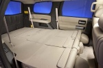 Picture of a 2016 Toyota Sequoia's Third Row Seats Folded in Sand Beige