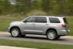 Picture of a driving 2016 Toyota Sequoia in Silver Sky Metallic from a rear left three-quarter perspective