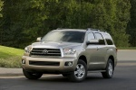 2016 Toyota Sequoia in Sandy Beach Metallic - Driving Front Left Three-quarter View