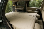 Picture of a 2017 Toyota Sequoia's Third Row Seats Folded in Sand Beige