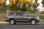 Picture of a driving 2017 Toyota Sequoia in Pyrite Mica from a right side perspective