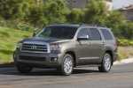 Picture of a driving 2017 Toyota Sequoia in Pyrite Mica from a front left three-quarter perspective