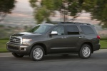 Picture of a driving 2017 Toyota Sequoia in Pyrite Mica from a front left perspective