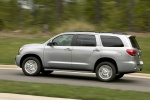 Picture of a driving 2017 Toyota Sequoia in Silver Sky Metallic from a rear left three-quarter perspective