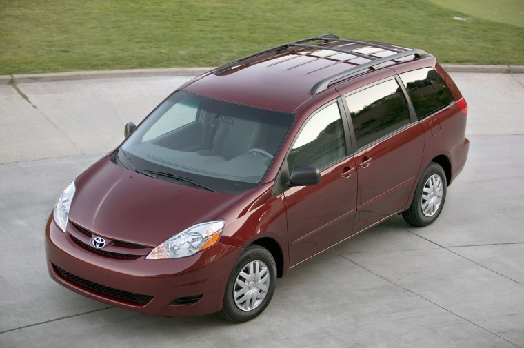 2010 Toyota Sienna LE in Salsa Red Pearl from a front left three-quarter top view