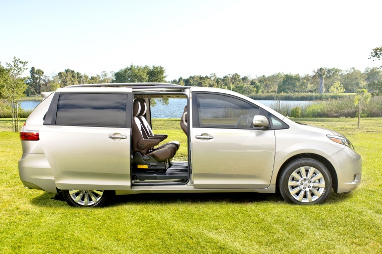 2016 Toyota Sienna Limited AWD with side-door open in Creme Brulee Mica from a side view