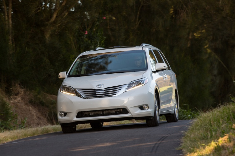 Driving 2017 Toyota Sienna Limited in Super White from a front left view