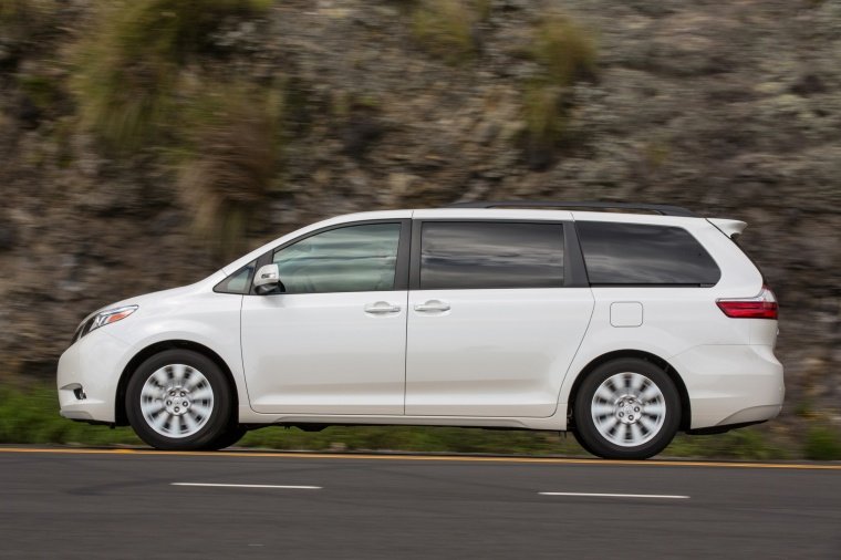 Driving 2017 Toyota Sienna Limited in Super White from a side view