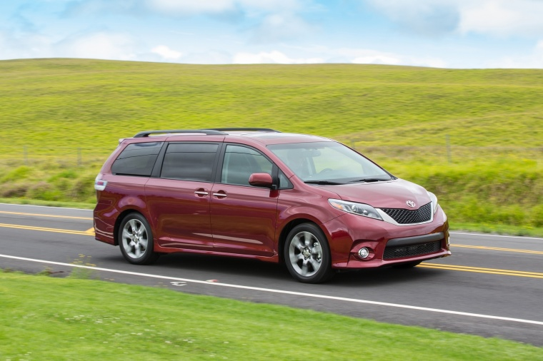 Driving 2017 Toyota Sienna SE in Salsa Red Pearl from a front right three-quarter view
