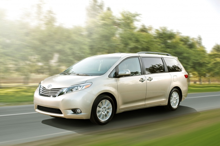 Driving 2017 Toyota Sienna Limited AWD in Creme Brulee Mica from a front left three-quarter view